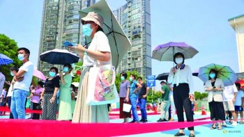 China's Xiamen city tells residents to stay home as COVID infection spreads